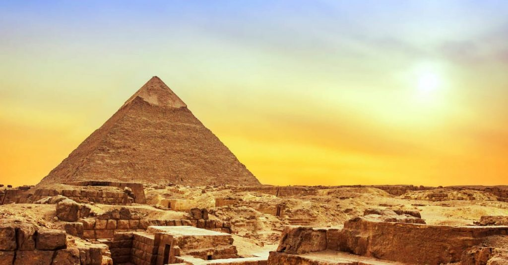 Picture of Giza pyramid with sunset in the back