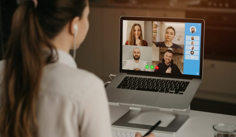 Young English teacher having an online meeting with her company.
